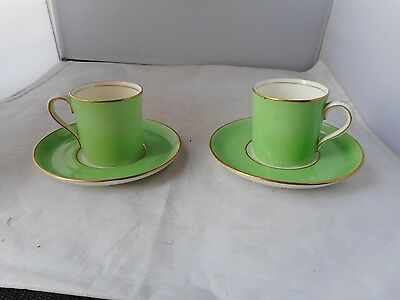 Two Aynsley Coffee Cans And Saucers