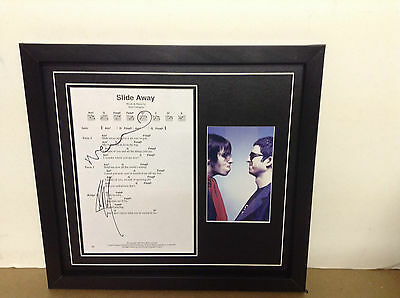 Oasis (Noel & Liam) Hand signed songsheet with Photo and COA