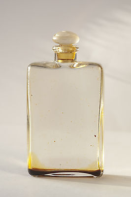Plain glass scent bottle with decorative swirl stopper, possibly Art Deco
