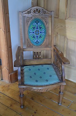 Antique reclining arm chair with beautiful embroidery