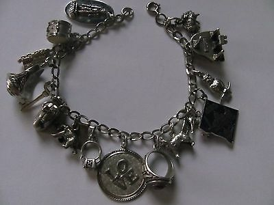 Vintage sterling silver charm bracelet with many great charms