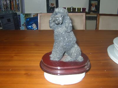 black resin sitting poodle ornament by castagia 6.5""