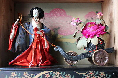 Antique Japanese gofun doll pulling a flower cart diorama in wooden box