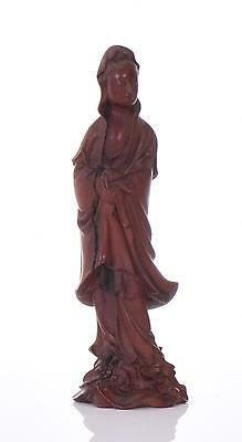 A Finely Carved Wood Guanyin Sculpture. The Go Lot 95