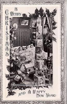 M03. Vintage Greetings Postcard. Children and presents.