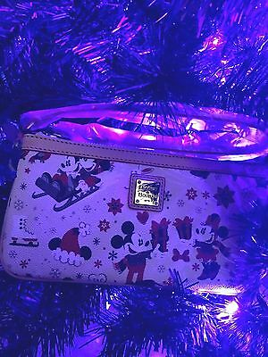SOLD OUT Dooney And Bourke Woodland Disney Christmas Wristlet NWT Sled Presents