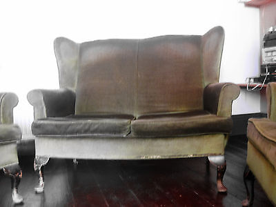 Three piece suite - sofa and two armchairs.
