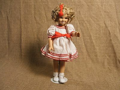 "Shirley Temple Vinyl Dress Up Doll celebrating 1934 movie, ""Stand Up And Cheer"""
