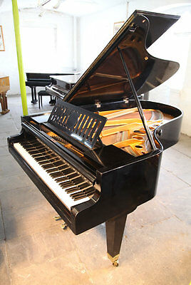 A 1935, Bosendorfer grand piano. Black case, slatted music desk & tapered legs