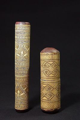 two finely carved lime powder containers - tribal artifact