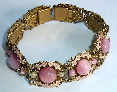 A VINTAGE 1930s GOLD TONE CZECH PAINTED ENAMEL BRACELET WITH PINK GLASS STONES