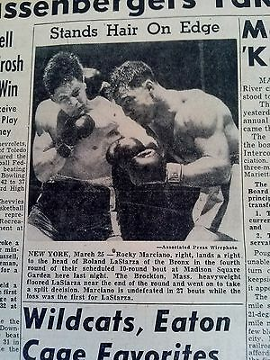 MAR 25, 1950 NEWSPAPER PAGE #3141- ROCKY MARCIANO LANDS A PUNCH ON LaSTARRA