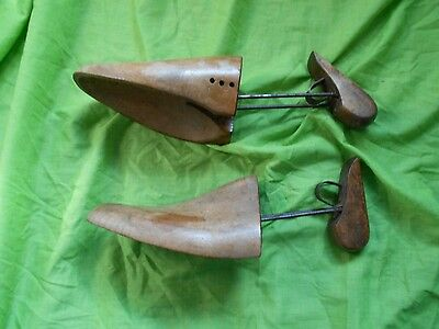 a vintage pair of wood and metal shoe trees