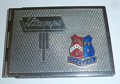 An Art Deco Chrome Plated Stamp Case With Cheddar Enamel Plaque