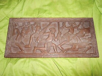 a vintage carved wooden African panel ....hunting scene