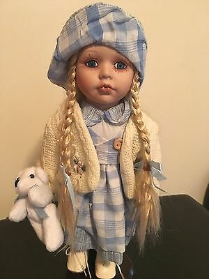 Collectable Porcelain Doll on Stand with Teddy bear
