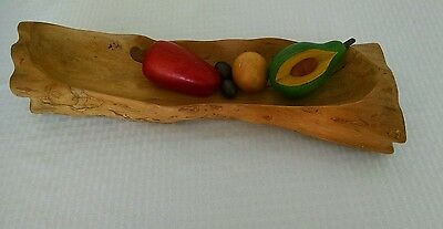 decorative wooden tray with neat wooden fruit
