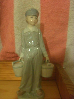 lladro boy in  dutch style with water buckets