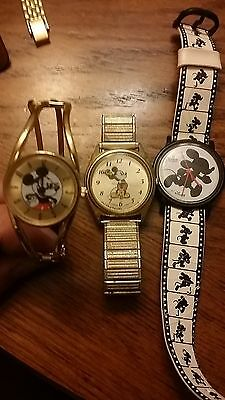 Lot of Mickey Mouse/ Disney watches and a set of Disney watchbands!