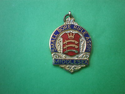 RIFLE CLUB MIDDLESEX ASSOC.SMALL BORE1978 ENAMEL BADGE.( postage & package FREE.