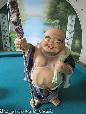 Japanese Laughing Buddha of Safe Travel - Hotei-on a journey with sack and staff