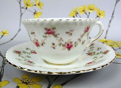 Antique CROWN STAFFORDSHIRE bone china cup & saucer. Hand painted roses. c 1910.