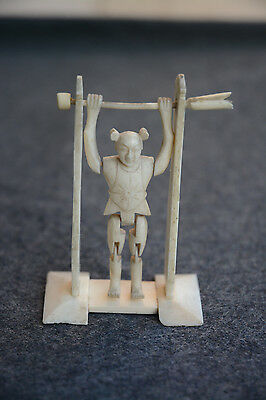antique chinese carved bovine bone miniature tumbling acrobat toy