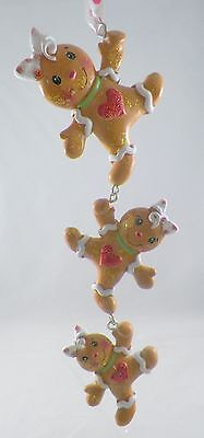 Strand of Gingerbread Girls with Heart Christmas Tree Ornament new holiday