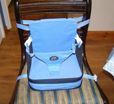 The First Years childs travel booster seat.