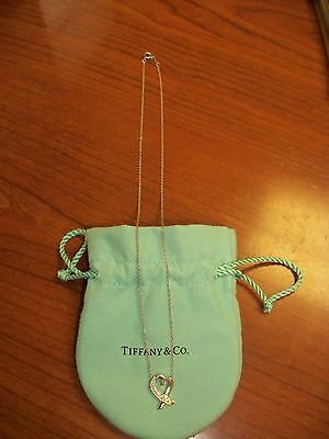 chaine or et diamand 18 carat 750 tiffany & co  signer paloma picasso