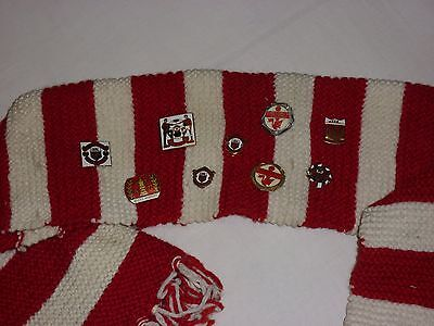 Collection Of Vintage Manchester United Badges On Scarf