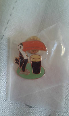 Guinness Toucan and pint pin badge.