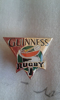Guinness Rugby pin badge.Gold coloured background.