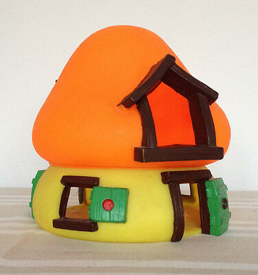 Large yellow Smurfs house with an orange roof
