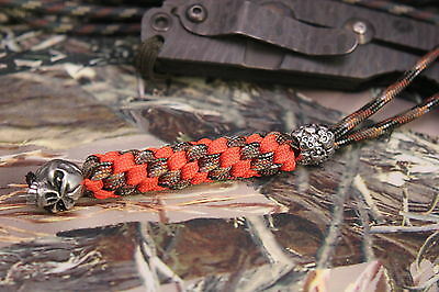 a 550 Paracord knife lanyard  fits most knives with a pewter emerson skull bead