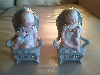 A pair of Bisque Baby Figurines