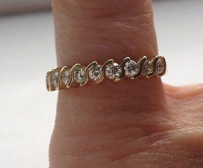 18 carat gold and Diamond Eternity Ring Size M 1/2 cleaned and polished lovely