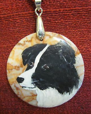 Border Collie hand painted on round Redline Marble pendant/bead/necklace