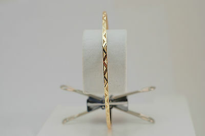 10K gold diamond cut bangle / bracelet