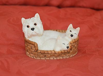West Highland White Terrier in basket with puppies figurine