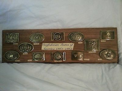 (12) REPRO Confederate Belt Buckles mounted on a wood plaque