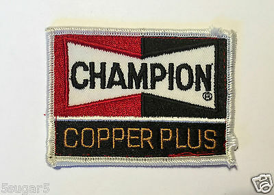 Vintage CHAMPION COPPER PLUS Embroidered PATCH -Black, Red, Copper on White 3.5""