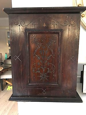 antique small mahogany wall cabinet with hinged door