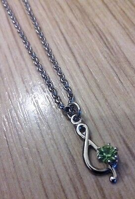 "Nickle ""treble Clef"" Sign Pendant. With Peridot Stone. Excellent Condition."
