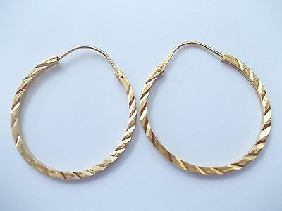 New Classic and elegant 18ct gold earrings
