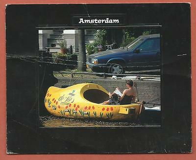 Postcard - 1 used - Netherlands...Amsterdam (wood shoe boat with woman reading)