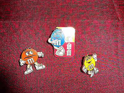 M&m's Pinback Hat Pin Blue M&m Flipping Coin Red And Yellow Background M&m Logo
