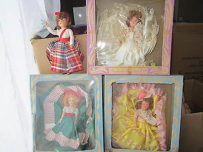 lot of 4 hard plastic dolls 3 in boxes