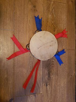 Old wooden vintage tambourine With Ribbons