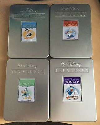 Four volume lot of Donald Duck Disney Treasures! Complete in tins!